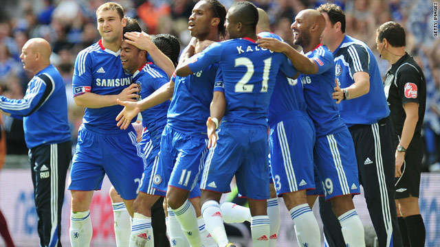 Chelsea players celebrate Didier Drogba's winning goal as the achieved the Premier League and FA Cup double at Wembley.