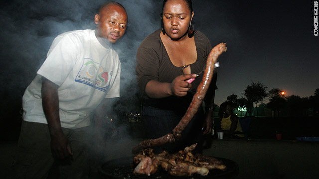 "South Africans grill food on a braai -- the Afrikaans for ""barbecue"" -- in Soweto in 2009."