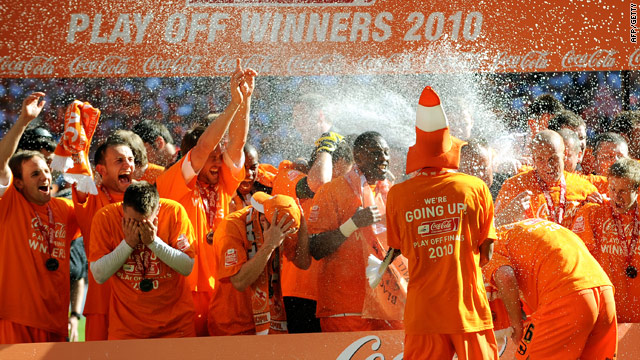 The champagne flows after Blackpool claim a place in the English Premier League after beating Cardiff at Wembley.