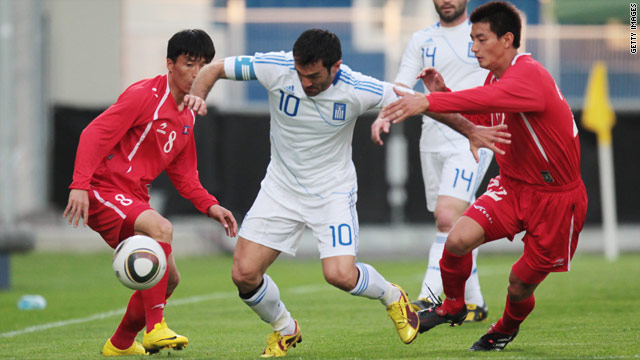 Greece's Georgios Karagounis battles to get past two North Korea players during their 2-2 draw in Austria.