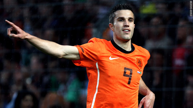 Robin van Persie celebrates scoring on his return to international football following a six-month injury lay-off.