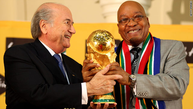 South African President Jacob Zuma (right) and FIFA president Sepp Blatter with the World Cup trophy.