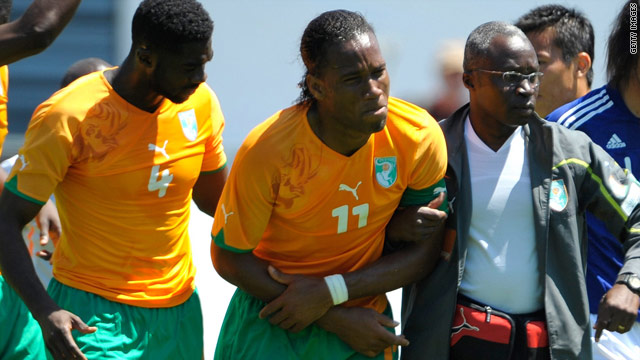 Didier Drogba is led from the field after breaking his arm during Ivory Coast's friendly with Japan.