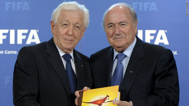 Frank Lowy, Football Federation Australia chairman, hands over his country's 2018 bid to FIFA president Sepp Blatter in May.