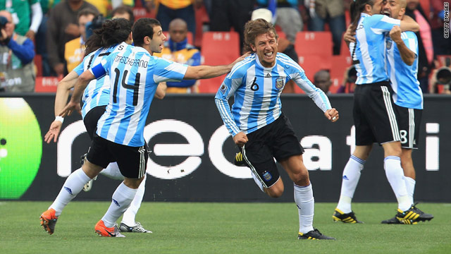 Gabriel Heinze wheels away in triumph after his early headed goal against Nigeria.