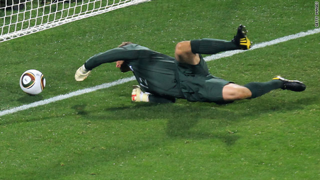 England goalkeeper Robert Green desperately tries to claw the ball back after his error.