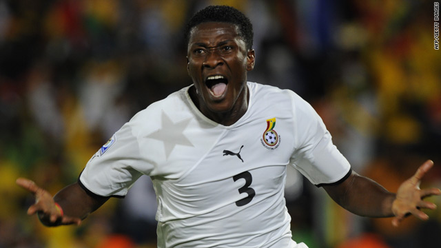 Asamoah Gyan celebrates scoring the penalty that gave Ghana victory over Serbia in the first Group D match.