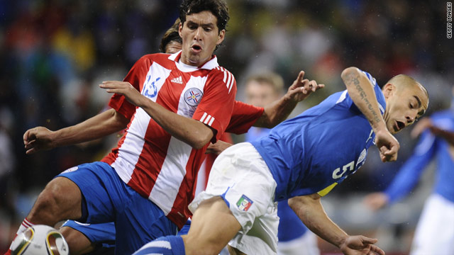Italy's World Cup-winning captain Fabio Cannavaro is muscled off the ball by Paraguay's Cristian Riveros.