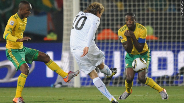 Diego Forlan (C) scores the first of his two goals for Uruguay against World Cup hosts South Africa.
