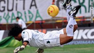 "Rene Higuita demonstrates his famous ""scorpion kick,"" though his erratic behaviour cost him in 1990."