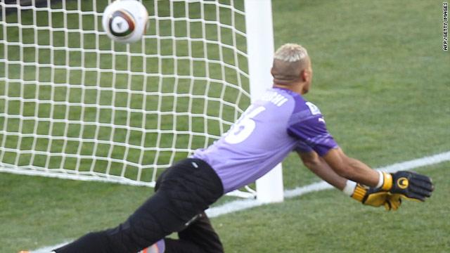 Algeria's goalkeeper Fawzi Chouachi looks helplessly as Robert Koren's shot hits the back of the net.
