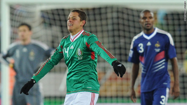 Javier Hernandez celebrates his opening goal for Mexico against France.