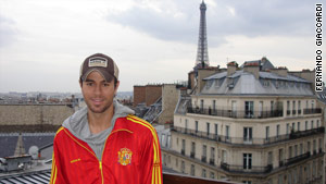 Enrique Iglesias wears his Spanish colors while in France as the World Cup unfolds.