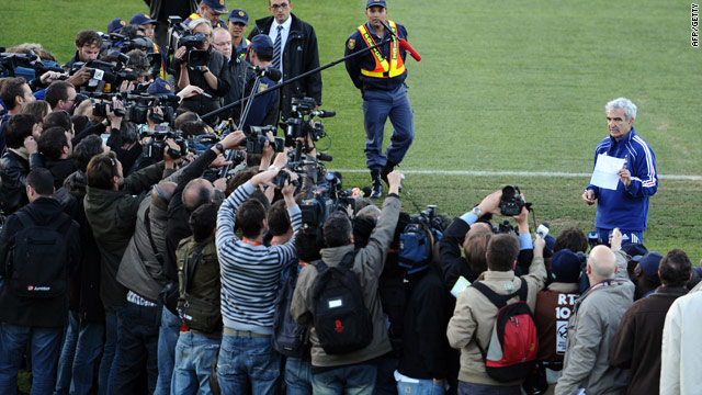 France coach Raymond Domenech faces a media scrum as he reads out the statement.