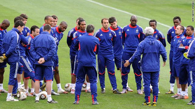 French coach Raymond Domenech addresses his players as the squad resumes training Monday.