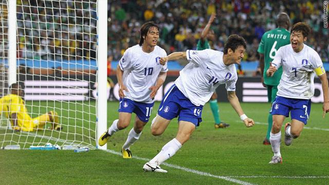 South Korea's Lee Jung-Soo (C) celebrates his goal against Nigeria.