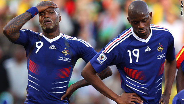 Djibril Cisse and Abou Diaby stand forlorn during France's defeat against South Africa that dumped them out of the World Cup.