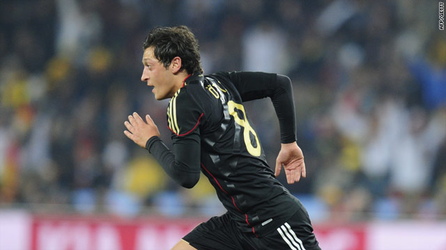 Ozil celebrates his goal which secured top spot in Group D for Germany