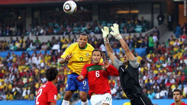 Brazil striker Luis Fabiano leaps to try and meet a cross in the company of Portuguese defenders.
