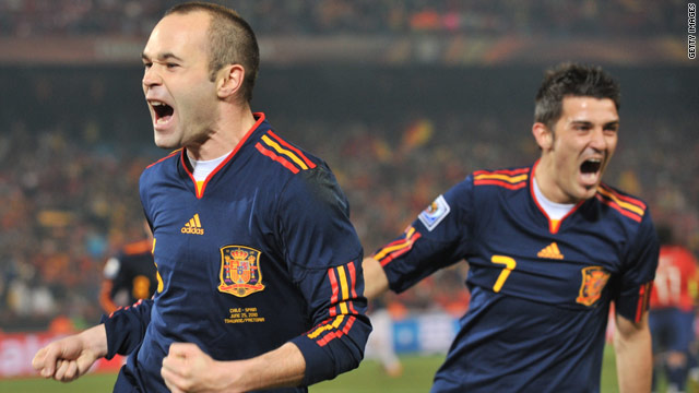 Spain's Andres Iniesta (L) celebrates his strike with fellow goalscorer, David Villa.
