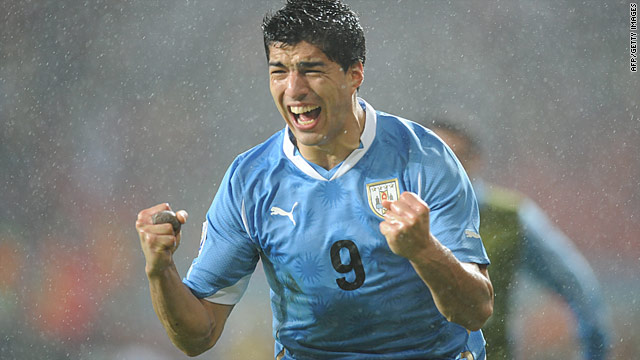 Luis Suarez celebrates in the rain after scoring Uruguay's winning goal against South Korea in South Africa.