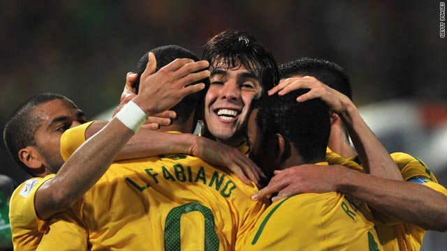 Kaka (center) celebrates with team-mates after Luis Fabiano scores Brazil's second goal.