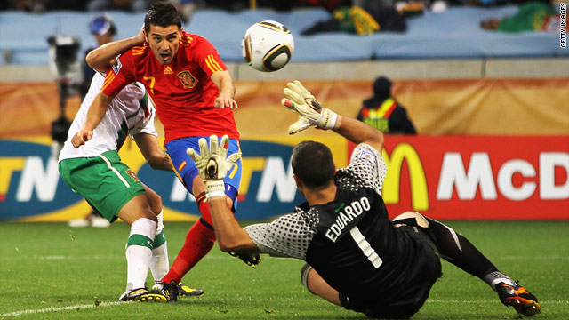 David Villa slots the winning goal past Portugal goalkeeper Eduardo as Spain made the World Cup quarterfinals.