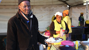 Lazarus Tlhahlane sells meals to volunteer workers.