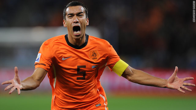 Giovanni van Bronckhorst celebrates after scoring a super long-range strike in the semifinal win against Uruguay.