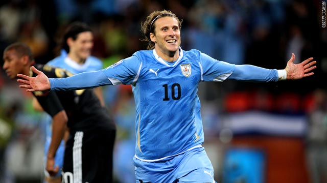 Diego Forlan celebrates scoring his fifth goal of the 2010 World Cup against Germany.
