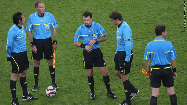 Match officials gather ahead of the Europa League final between Atletico Madrid and Fulham on May 11.