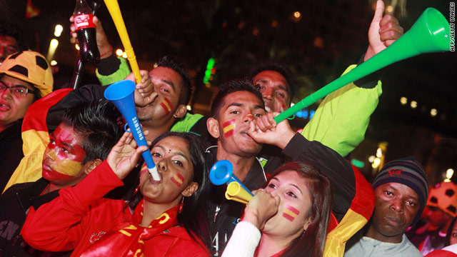 Spain supporters blow vuvuzelas at the Durban fan park ahead of the World Cup final on July 11.