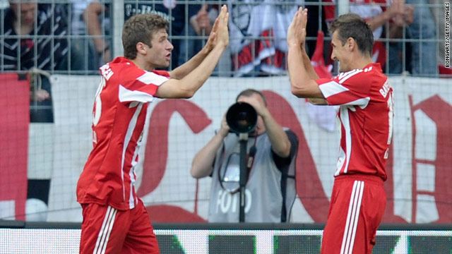 Thomas Mueller and Miroslav Klose celebrate Bayern Munich's opening goal against Schalke on Saturday.