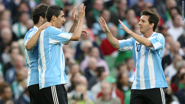 Angel Di Maria, center, celebrates his goal against Ireland with Argentina teammate Lionel Messi, right.