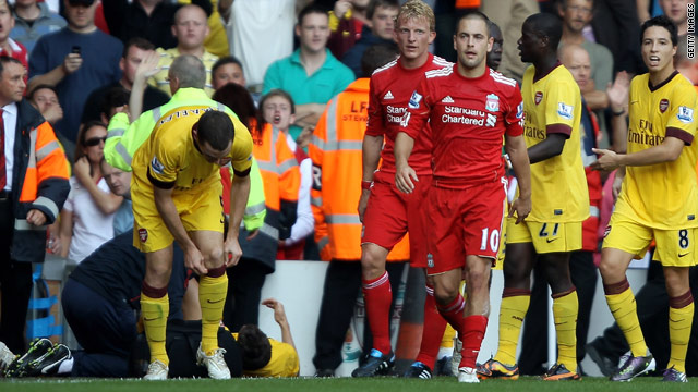Liverpool's Joe Cole trudges off after being shown red by referee Martin Atkinson.
