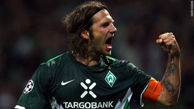 Torsten Frings celebrates after scoring Werder Bremen's second from the penalty spot.