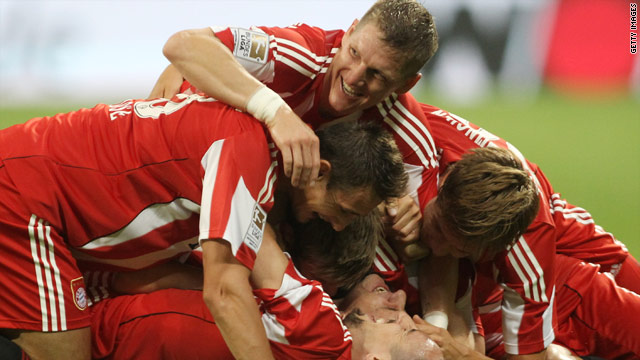 Bayern players celebrate their last-gasp 2-1 Bundesliga victory over Wolfsburg on Friday.