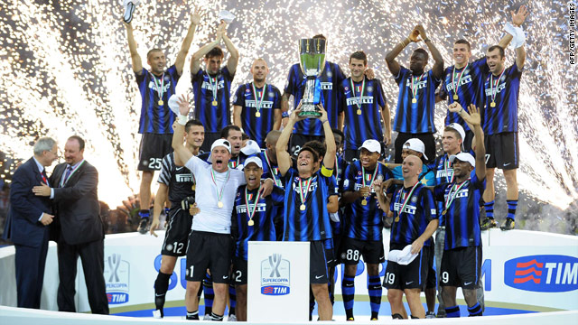 Inter Milan's players celebrate after clinching their fourth trophy this year with victory in the Italian Super Cup.