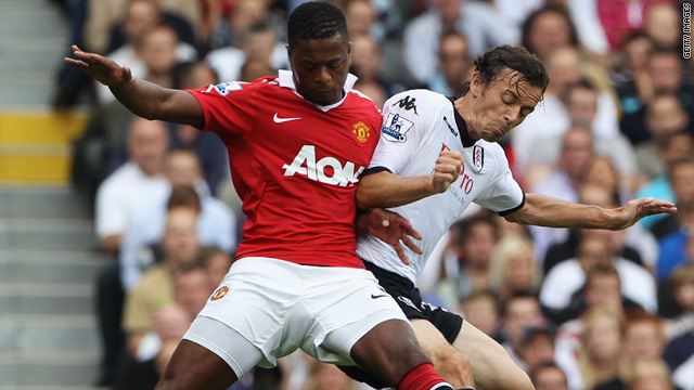 Simon Davies (right) scored Fulham's first equalizing goal in their thrilling 2-2 home draw with Manchester United.
