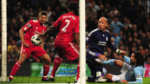 Manchester City's second goal against Liverpool finds its way over the line.