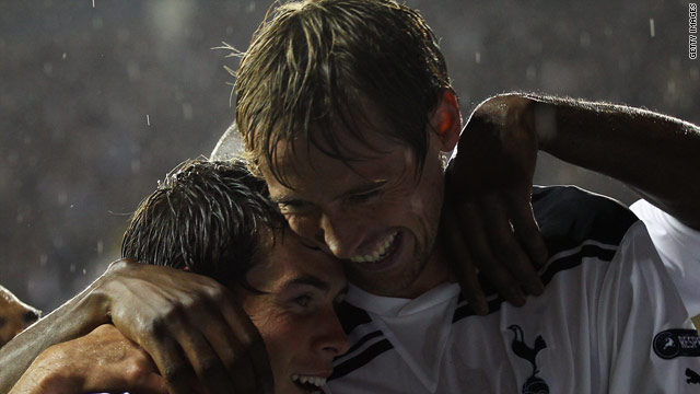 Peter Crouch celebrates his hattrick for Tottenham Hotspur with teammate Gareth Bale (left).