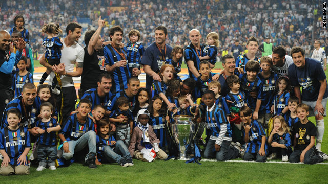 Inter Milan players and family celebrate their victory in last season's Champions League final against Bayern Munich.