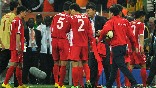 Coach Kim Jong Hun talks to his players after their 3-0 defeat to Ivory Coast.