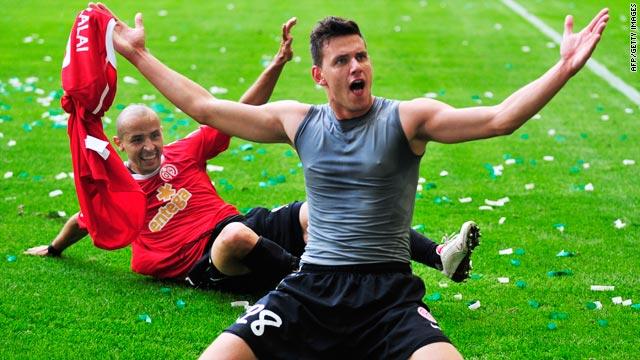 Mainz striker, Adam Szalai celebrates after scoring the winning goal against Wolfsburg.
