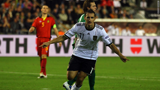 Miroslav Klose scored the only goal as Germany began their campaign with a narrow victory in Belgium.