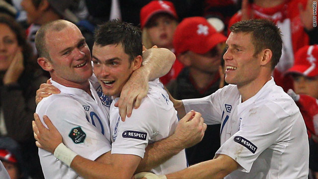 Wayne Rooney (L) is congratulated by Adam Johnson (C) and James Milner after scoring for England against Switzerland.