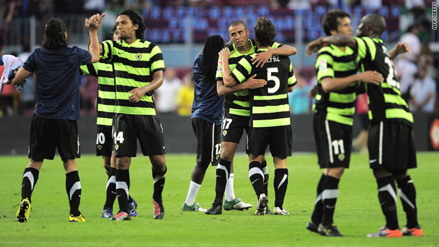 Hercule's players celebrate their 2-0 victory over champions Barcelona at the Camp Nou Stadium on Saturday.