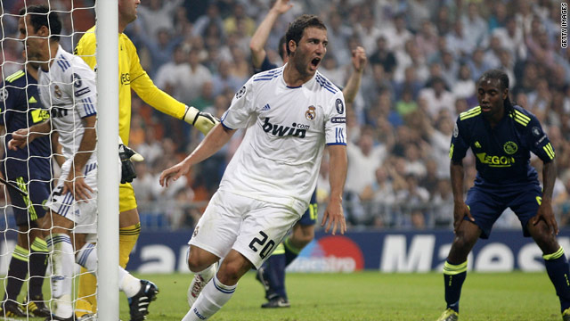 Gonzalo Higuain celebrates Real Madrid's opening goal against Ajax in the Champions League
