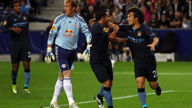 David Silva (far right) celebrates his first goal for the club in Manchester City's victory in Austria.