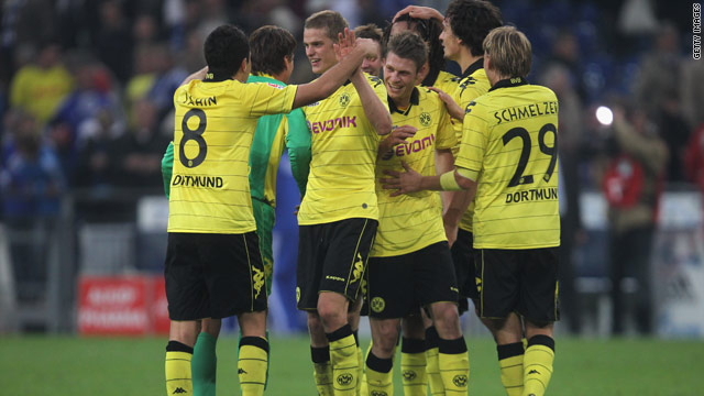 Dortmund players celebrate their win over local rivals Schalke, who are still pointless after four matches.